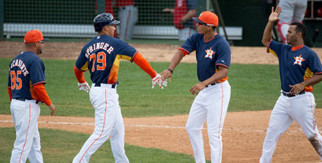 George Springer and Carlos Correa (center right) could become two huge pieces in Houston.