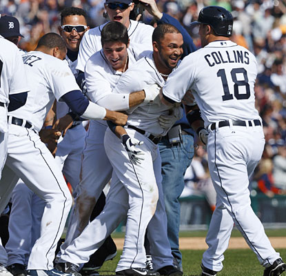 Alez Gonzalez's first game for Detroit ends with Tigers teammates mobbing the veteran shortstop.  (ULive)
