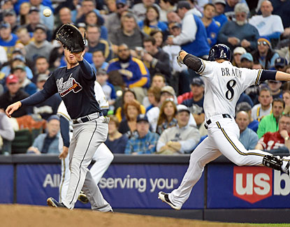Ryan Braun is ruled safe at first but the call is the first to be overturned after a replay review. (USATSI)