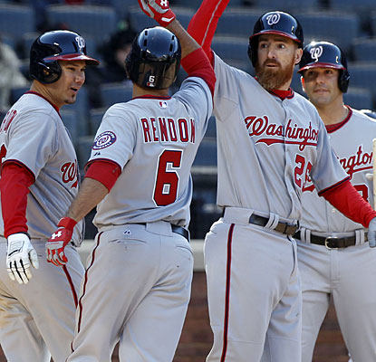 Anthony Rendon's three-run home run in the 10th sparks a celebration for the Nats in the season opener.  (USATSI)