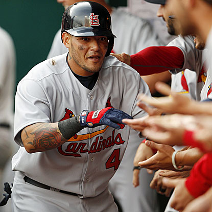 Yadier Molina celebrates with teammates after belting a seventh-inning homer in a 1-0 win over the Reds. (USATSI)