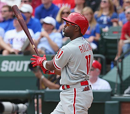 Jimmy Rollins follows through on his 200th home run and makes it a memorable one -- a grand slam on Opening Day.  (Getty Images)