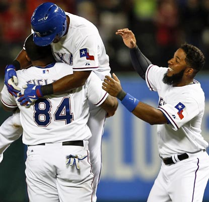 The Rangers mob Adrian Beltre after he smacks a game-winning single in the ninth inning to beat the Phillies.  (USATSI)