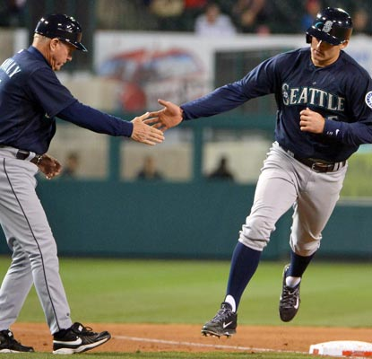 Brad Miller goes yard twice and the Mariners start the season 2-0 against their AL West rivals.  (USATSI)