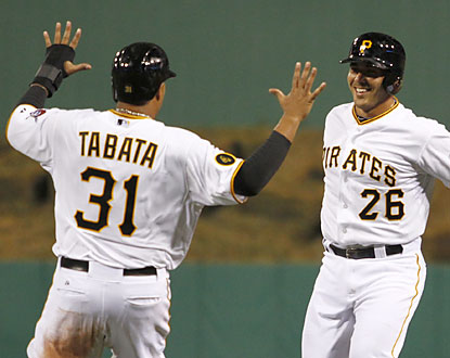 Pinch-hitter Tony Sanchez (right) helps the Pirates prevail in the longest game timewise (5:55) in Pittsburgh history. (Getty Images)