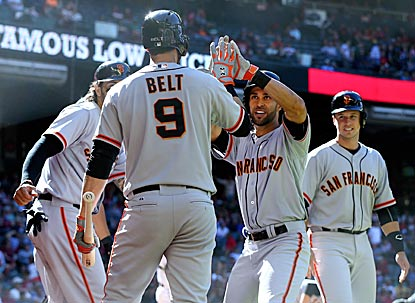 Teammates greet Angel Pagan after putting the Giants ahead to stay with a three-run roundtripper in the eighth inning.  (USATSI)