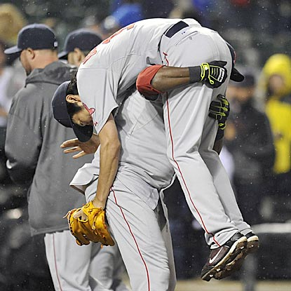 They're at it again: David Ortiz picks up Koji Uehara after the closer nails down a save against his old team.  (USATSI)