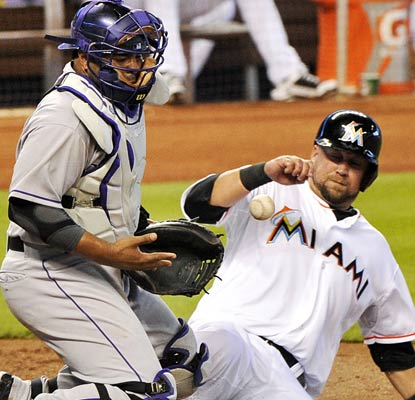Casey McGehee slides safely into home plate and the Marlins are off to a fast start at 3-1.  (USATSI)