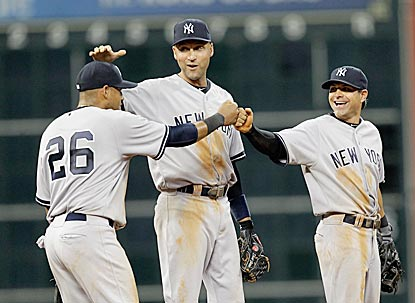 Derek Jeter and Brian Roberts commend Yangervis Solarte (26) on a productive first start in the big leagues.  (Getty Images)