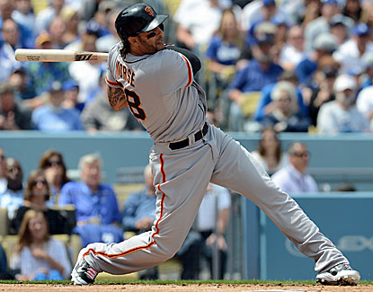 Michael Morse helps the Giants put up a six-run first inning to spoil the Dodgers' home opener.  (USATSI)