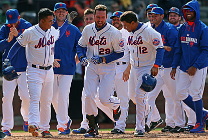 Ike Davis (No. 29), who lost his starting job at first base a day earlier, comes up clutch to bail out the Mets. (USATSI)