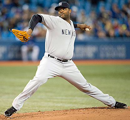 CC Sabathia strikes out six and allows four runs on seven hits to pick up his first win. (Getty Images)