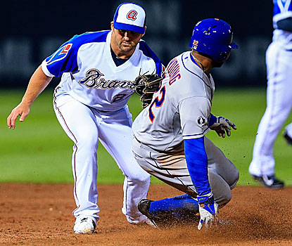 Eric Young Jr. slides into second before the tag by Braves second baseman Dan Uggla in the third inning of the Mets win. (USATSI)