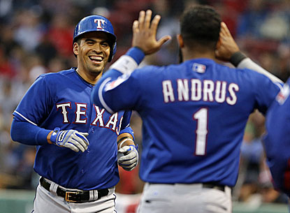 Robinson Chirinos is congratulated by Elvis Andrus after hitting a home run against the Red Sox in the third. (USATSI)