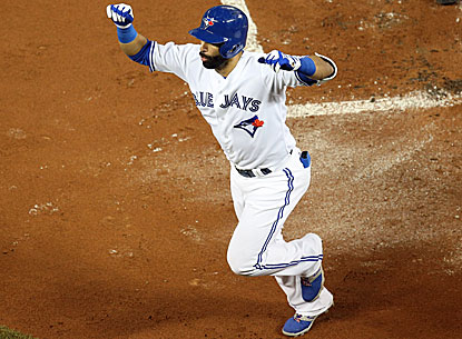 Jose Bautista reaches home plate and celebrates his solo home run in the first inning against the Astros.  (USATSI)