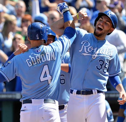 Alex Gordon is greeted at the plate by Eric Hosmer after knocking a three-run shot -- the Royals' first home run this season.  (USATSI)
