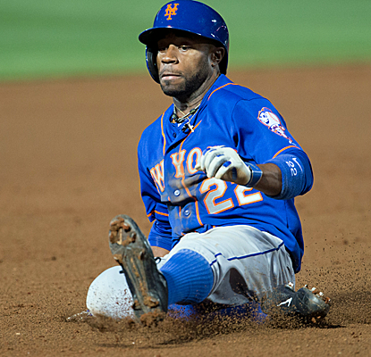 Eric Young Jr. slides safely into third after a long triple to center, and the Mets take out the Braves.  (USATSI)