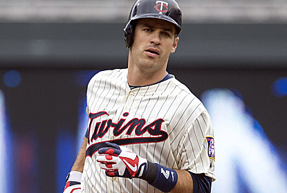 Joe Mauer hits a three-run shot for the Twins, who have scored the second-most runs in the AL. (USATSI)