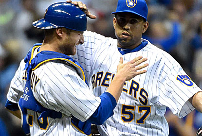 Jonathan Lucroy, who drives in the game winner, celebrates with closer Francisco Rodriguez. (USATSI)