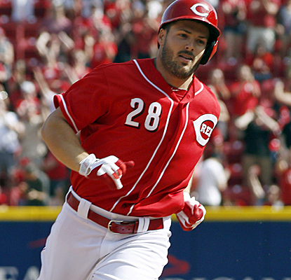 Chris Heisey rounds the bases after hitting his first-career grand slam, and the Reds get the win.  (USATSI)