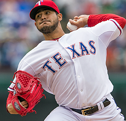 Martin Perez throws eight scoreless innings, and Rangers give him just enough offense to get the win.  (USATSI)