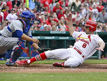 St. Louis' Peter Bourjos slides in safely past Welington Castillo on Matt Carpenter's sacrifice fly in the fourth inning.  (USATSI)