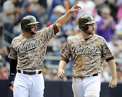 Yonder Alonso (left) salutes Will Venable and he and Chase Headley (right) score on Venable's double in the fourth inning.  (USATSI)