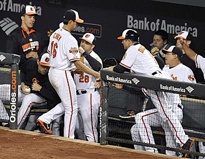 The Orioles greet Wei-Yin Chen after he limits the Rays to one run and five hits in 6 1/3 innings.  (USATSI)