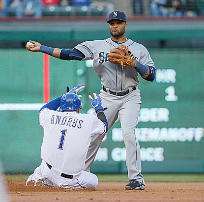 Elvis Andrus' slide into second doesn't prevent Robinson Cano from turning a double play in the first inning.  (USATSI)