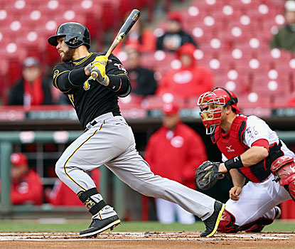 The Pirates' Russell Martin singles in the seventh inning, bringing in the winning run against the Reds. (Getty Images)