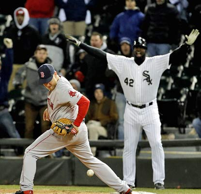 Mike Carp is unable to handle the throw to first, ending a long, frigid night in Chicago on a losing note for the Red Sox.  (USATSI)