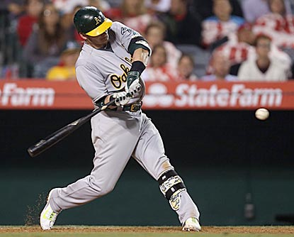 Oakland's Josh Donaldson connects on the double that drives in the deciding run in the 11th inning. (Getty Images)