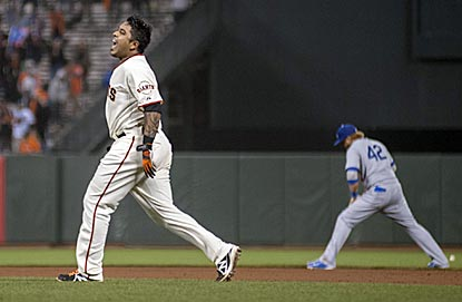 Hector Sanchez exults after his hit gives the Giants the victory in their first home game against the rival Dodgers in 2014. (USATSI)
