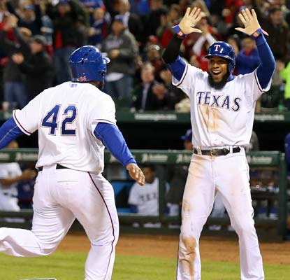 Elvis Andrus greets Prince Fielder at home plate after they both score off a double in the eighth inning. (USATSI)
