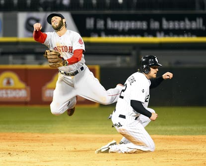 Boston's Dustin Pedroia forces out Chicago's Conor Gillaspie at second base in the 10th inning.  (USATSI)