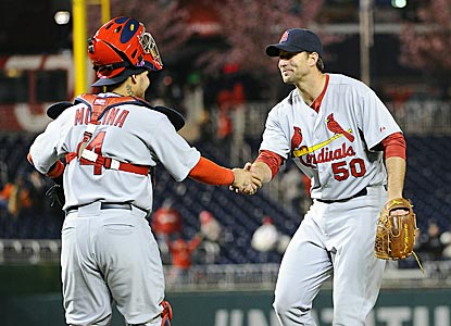 Yadier Molina congratulates Adam Wainwright on the fourth two-hit shutout of his career.  (USATSI)