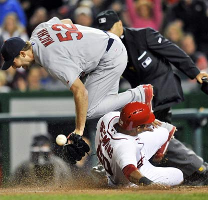 Michael Wacha can't make the play as Ian Desmond slides home in the seventh inning of Washington's win.  (USATSI)