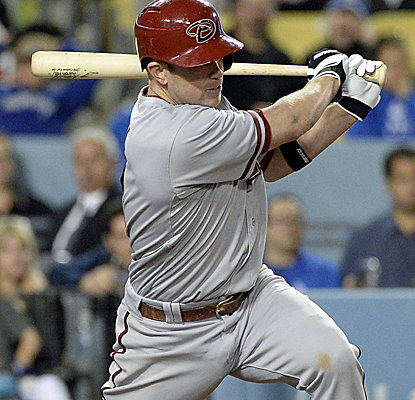Aaron Hill plates the winning runs with a 12th-inning single to lift the Diamondbacks past the Dodgers.  (USATSI)