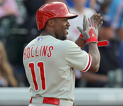 Jimmy Rollins finishes with three hits, including a homer and a go-ahead single in the eighth that propels Philly to victory. (Getty Images)