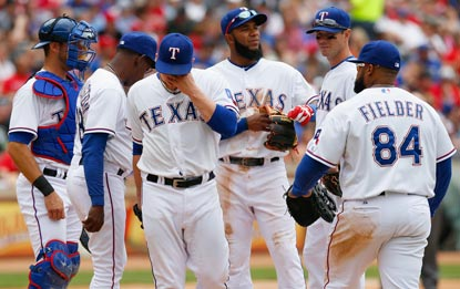 It's that kind of a day for Robbie Ross and the Texas pitching staff, which yields 18 hits, including nine extra-base hits.  (Getty Images)