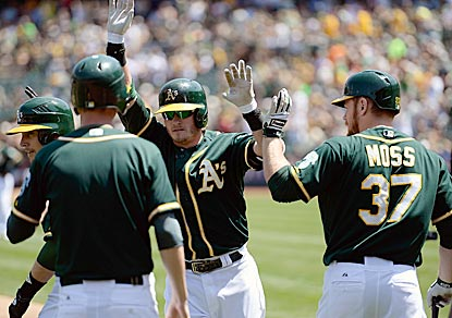 Josh Donaldson (center) gets Oakland started with a two-run blast in the first inning. He adds an RBI double in the seventh. (Getty Images)