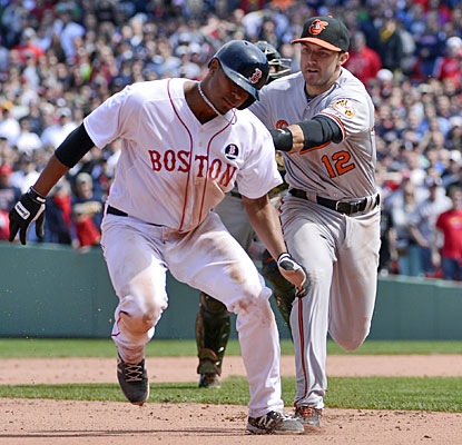 The Orioles get Xander Bogaerts caught in a rundown for the final out of the eighth inning, ending a Red Sox rally.  (USATSI)
