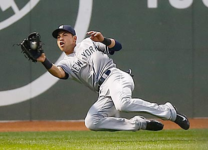 Jacoby Ellsbury has a big first inning as an opponent at Fenway. He hits a leadoff triple, then makes this sliding catch.  (Getty Images)