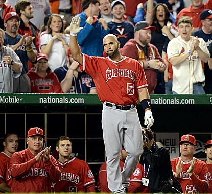 Albert Pujols takes a bow after hitting his 500th home run. Pujols reaches the milestone with his 47th multihomer game.  (Getty Images)