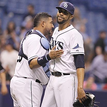 Jose Molina congratulates David Price on his complete game. Price co-led the American League with four last season.  (USATSI)
