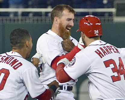 The Nats swarm Adam LaRoche, who delivers the game-winning hit in the ninth inning to complete the comeback. (USATSI)