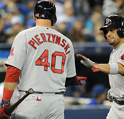 Shane Victorino congratulates A.J. Pierzynski, who comes through with his eighth career grand slam. (USATSI)