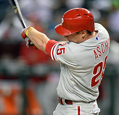 Pinch-hitter Cody Asche connects for a two-run double during Philadelphia's four-run eighth inning. (USATSI)