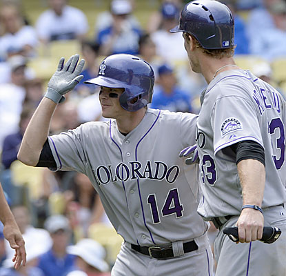 Josh Rutledge breaks open the game in the sixth with a three-run homer to help the Rockies win their fourth straight series. (USATSI)