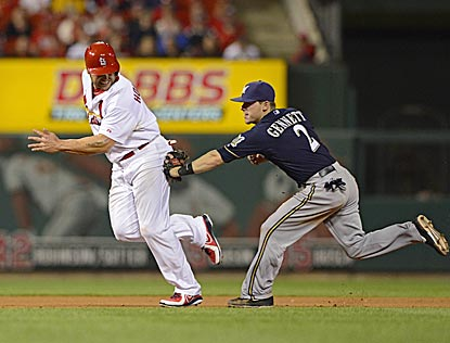 In a rundown, Scooter Gennett tags Matt Holliday, who tried to advance to third on Peter Bourjos' sac bunt attempt in the 10th. (USATSI)